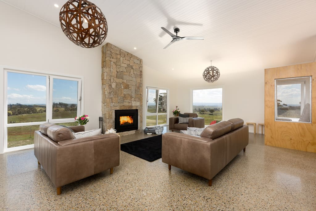 stylish lounge room - open fire and underfloor heating