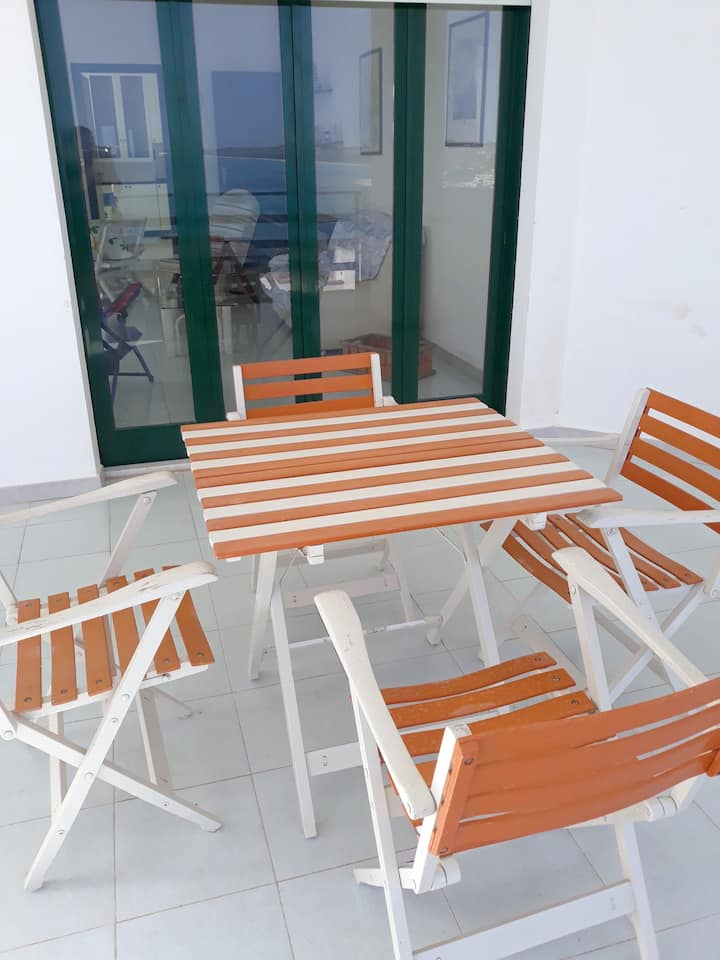 Apartment with 2 bedrooms in Seccagrande, with wonderful sea view, enclosed garden and WiFi - 300 m from the beach