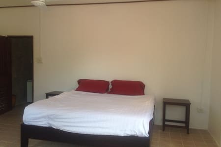 Nice sunny bedroom with double bed - Luang Prabang
