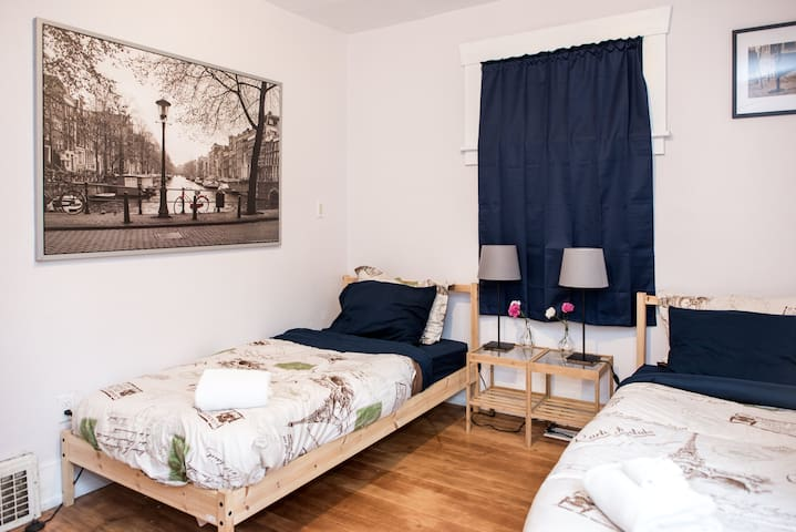 The European Room - Shared Coed (Left Bed)