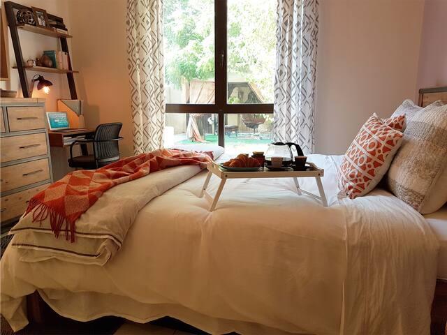 Master bedroom w/ study desk and garden outlook