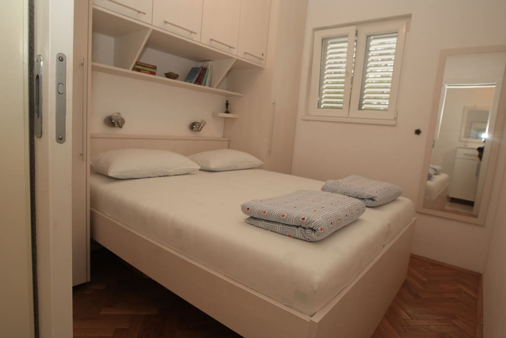 Bedroom 1/2 - double bed, small room but plenty of storage and ceiling fan for the warm nights