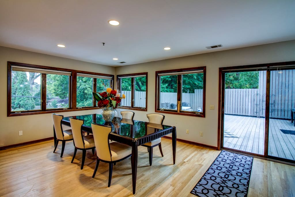 Very Large, Stunning Dining Room table. Lots of light!  Notice the sliding glass door to the outdoor patio.