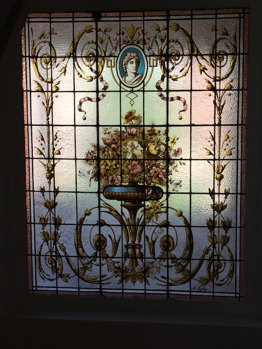 A vintage 1900 stained glass in the wide staircase