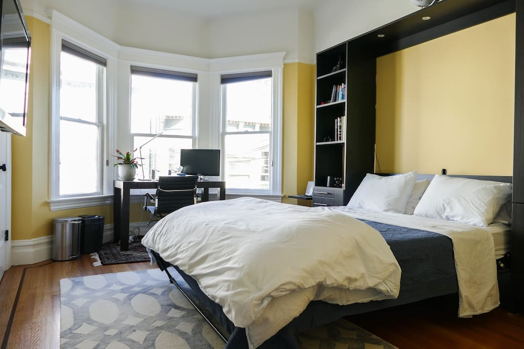 Bright and large bedroom with a Murphy Bed. It is a brand-new, queen-sized, memory-foam Casper mattress. Ceiling fan and light are controlled via a remote located in the room.