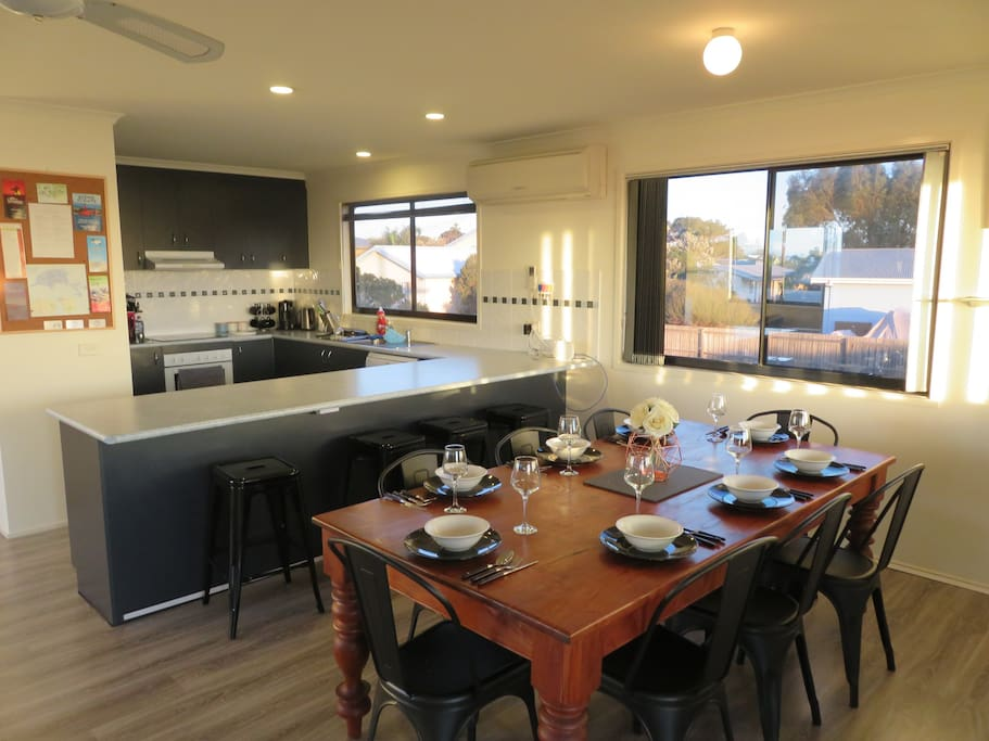 Large kitchen with all the cookware, glassware and crockery you'll need, breakfast bar (four seats), and eight place dining table