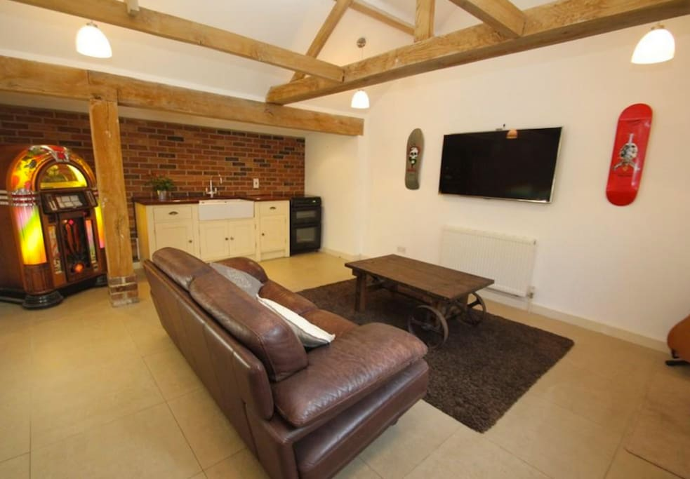 Open plan kitchen and living room with 55inch Samsung TV