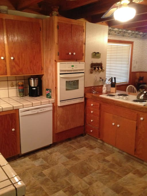 Kitchen with dishwasher and microwave