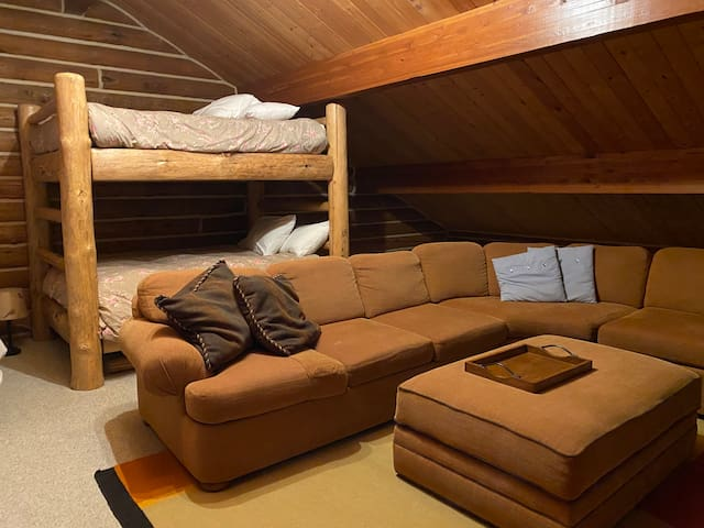 Upstairs sleeping loft and family room. Bunk Bed is a full/full.