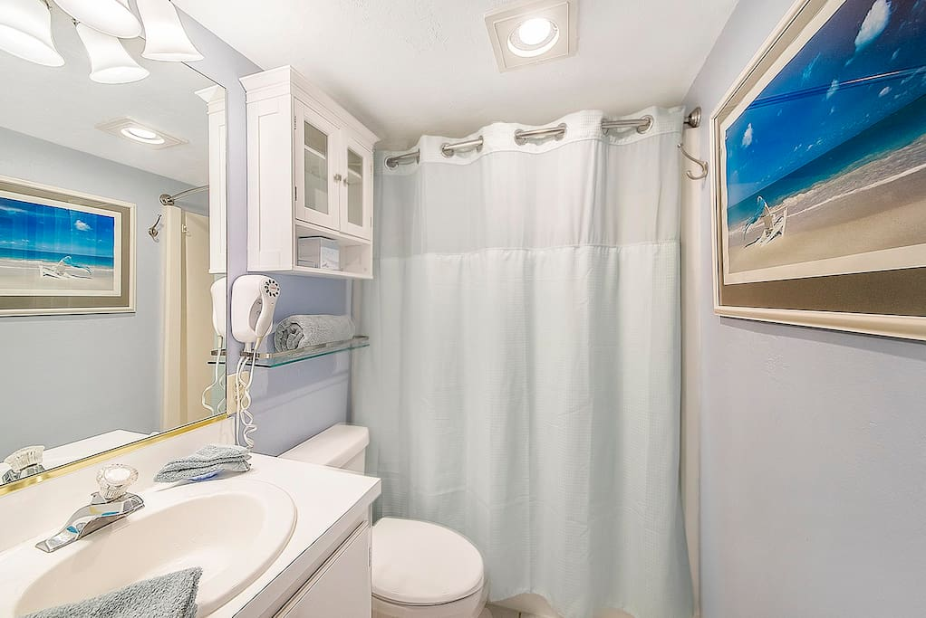 Bathroom includes towels and hairdryer