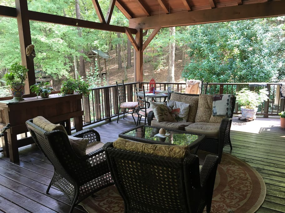 Large covered porch in common area, guest use only