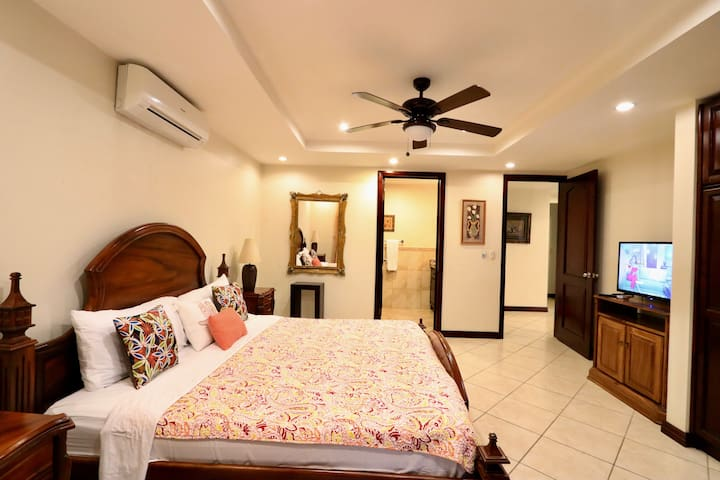 Master bedroom with king bed, a/c, cable tv and private bathroom