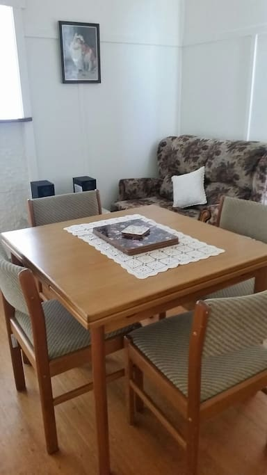 Dining room with gas heater table extends to seat 6.