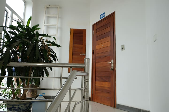 take the stair to sixth floor ( here is our apartment front door _ number 600 )