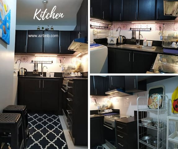 KITCHEN  Electric range complete with kitchen equipment and utensils you will need. Kitchen carpet. Automatic washing machine is provided for easy laundry. Enjoy cooking with the drop light. This is a home experience!