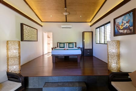Beach Villa with Lounge are that can accommodate two additional single beds