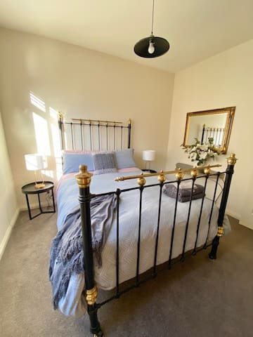 Beautiful sunny room with double bed and antique wardrobe.