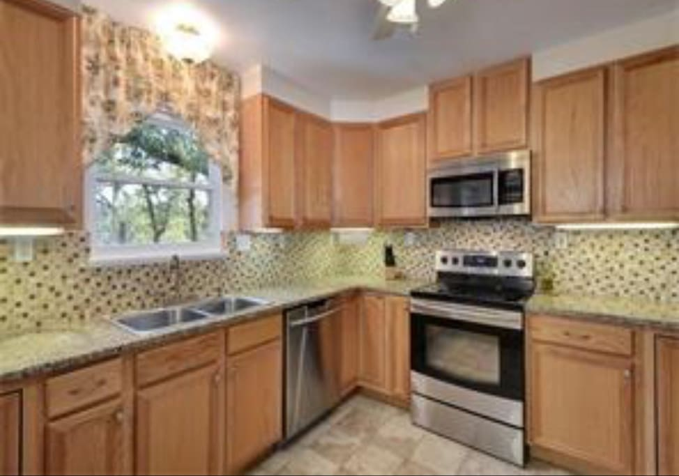 Kitchen with Granite Countertops and State of the Art Appliances