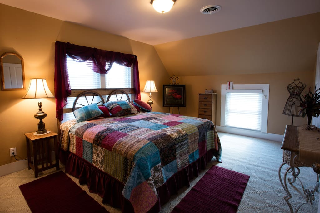 The Sunset Suite features a king bed, dressing vanity and walk-in closet.