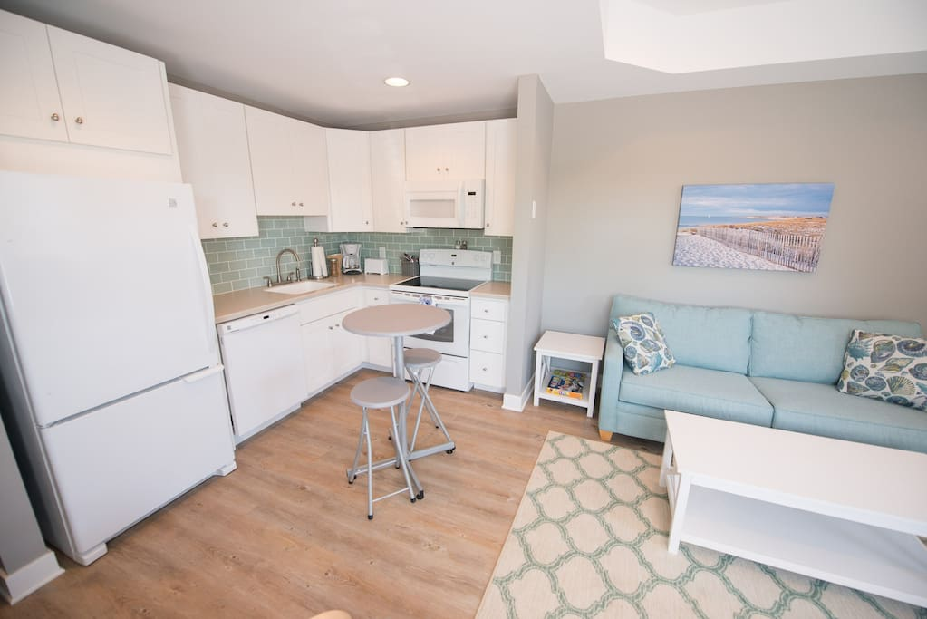 Efficient kitchen with all new appliances, cabinets and counter tops.
