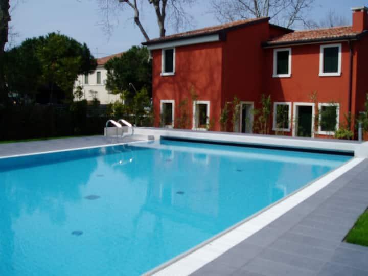 Ca'Rossa's apartment with swimmingpool