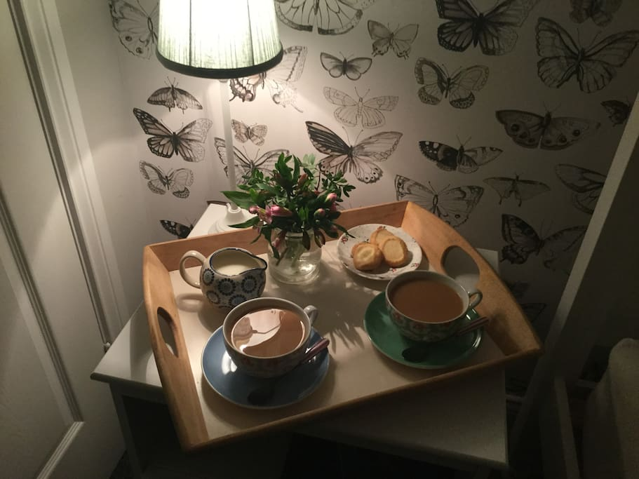 Tea tray with home baking, loose tea and fresh coffee