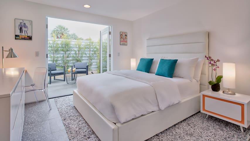 Bedroom #3: The orange bedroom- Queen bed, en-suite bath, private patio.