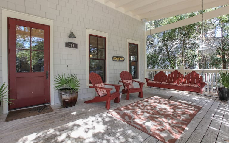 Airy front porch with porch swing and seating for 5