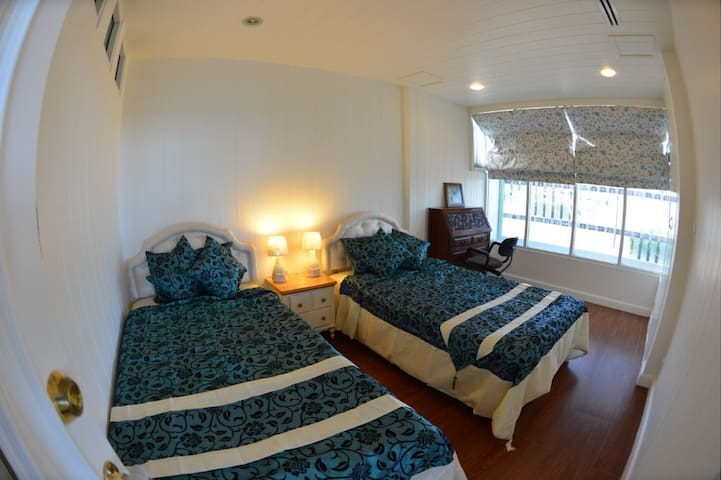 Lower Bedroom, 2 single beds with a single spare bed underneath.