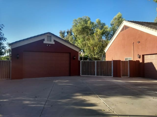 Front of the house. Casita is the structure on the left. Parking in the driveway (far left).