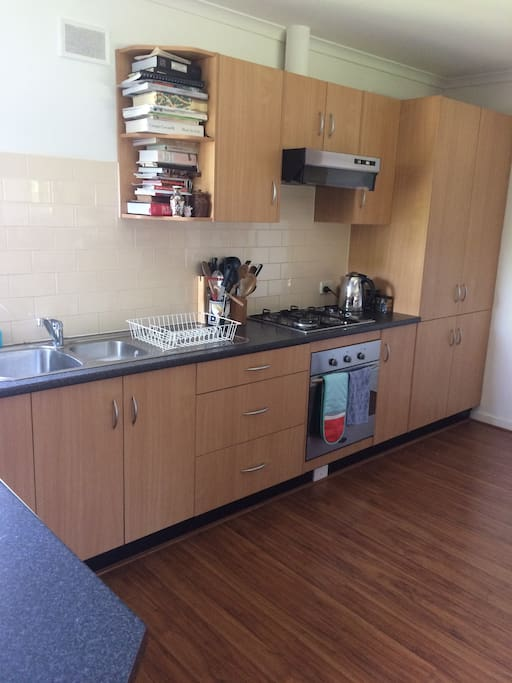 Large kitchen fully equipped with dishwasher