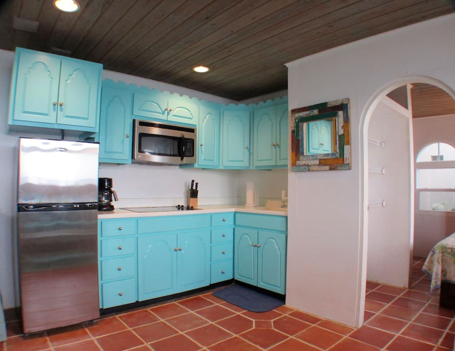 Newly painted kitchen area. Full kitchen with fridge, microwave and cook top.
