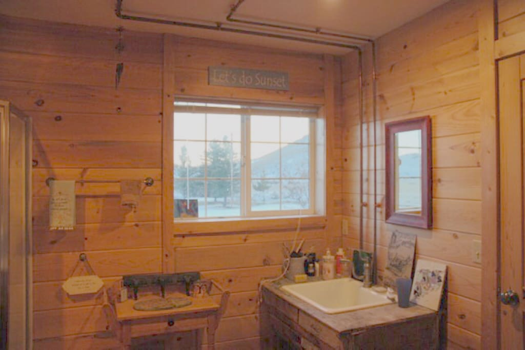 Pine paneled private bathroom with fab views!