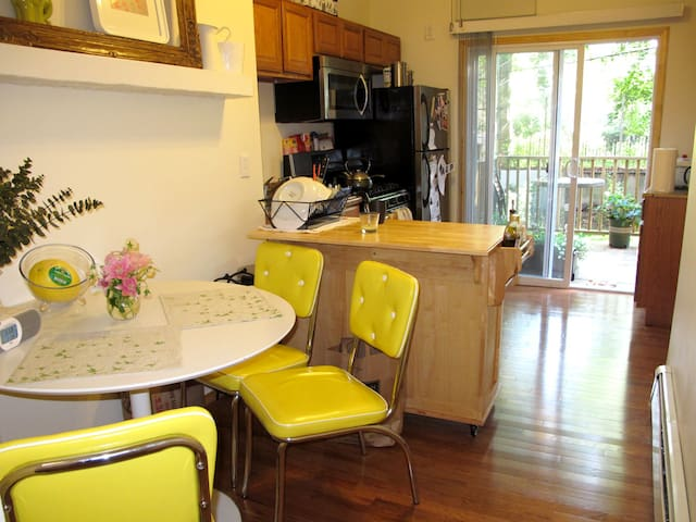 dinning room with kitchen open to the back yard