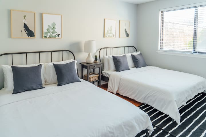 Queen size beds with premium linens and fluffy pillows
