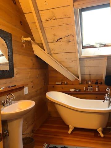upstairs bathroom with soaking tub and skylight....
