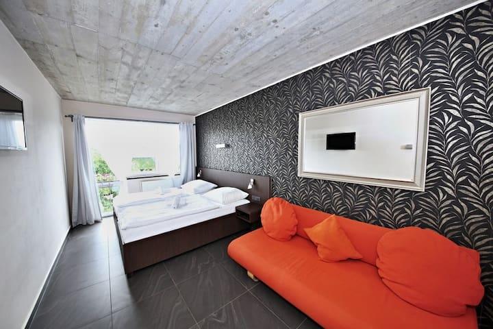 Twin room with sofa