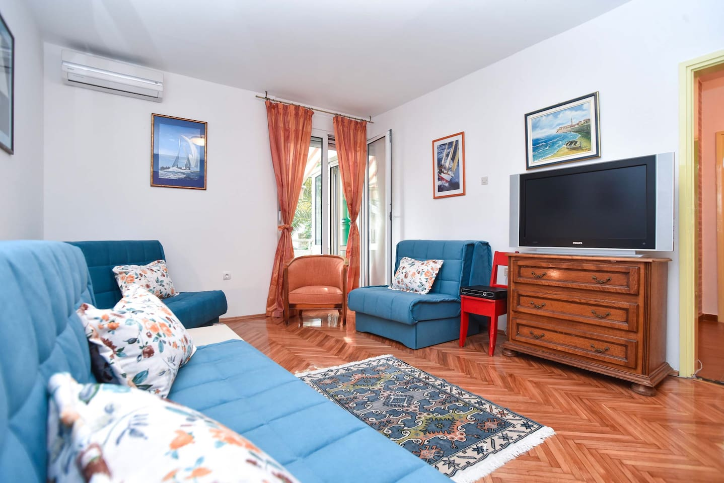 View of the living room of our specious one bedroom apartment near the Slovenska Beach and the Old Town