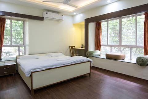 AC bedroom in a 3BHK flat in Koregaon Park.