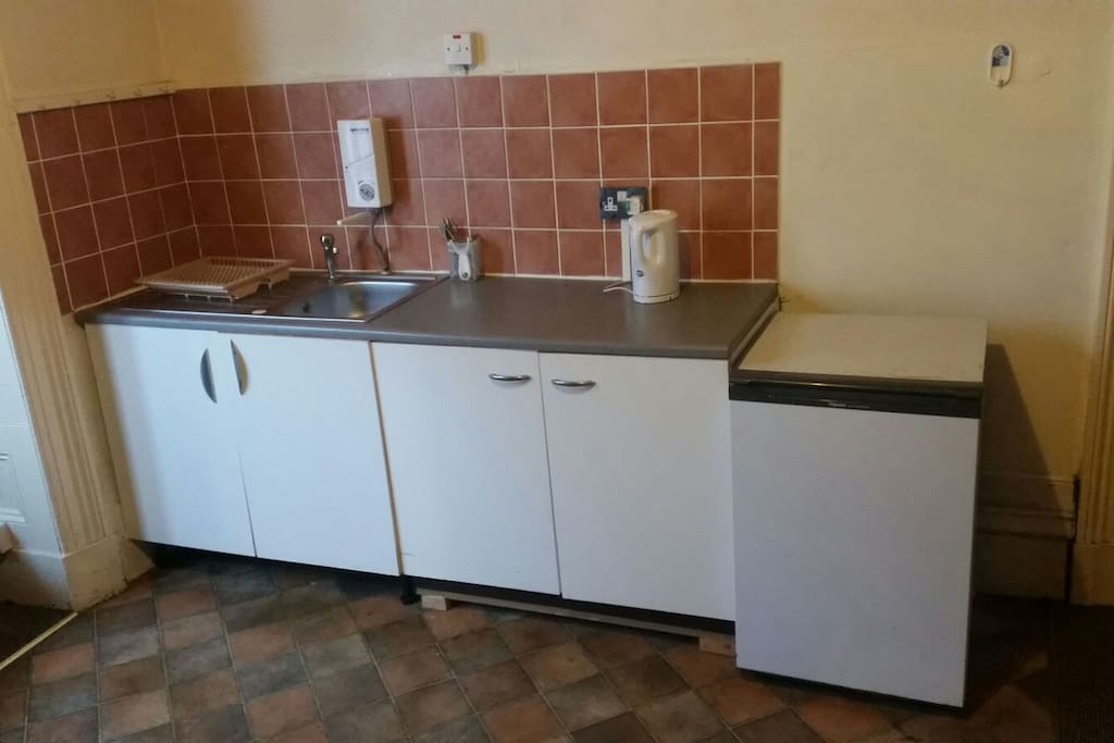 Small kitchen space and fridge