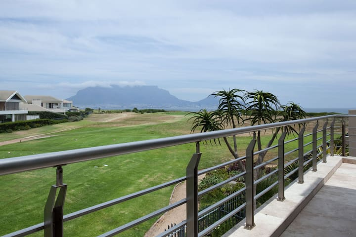 View over the golf course and sea to Table Mountain. Path to the beach which is about 100m away at the end of the fairway.