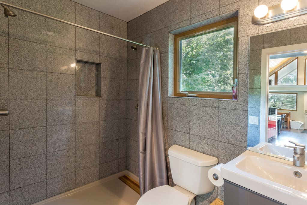 Bathroom walk-in shower has dual spray heads which are individually controlled.