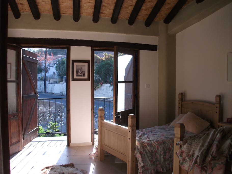 2nd Bedroom with Twin beds leading onto very large Balcony area.