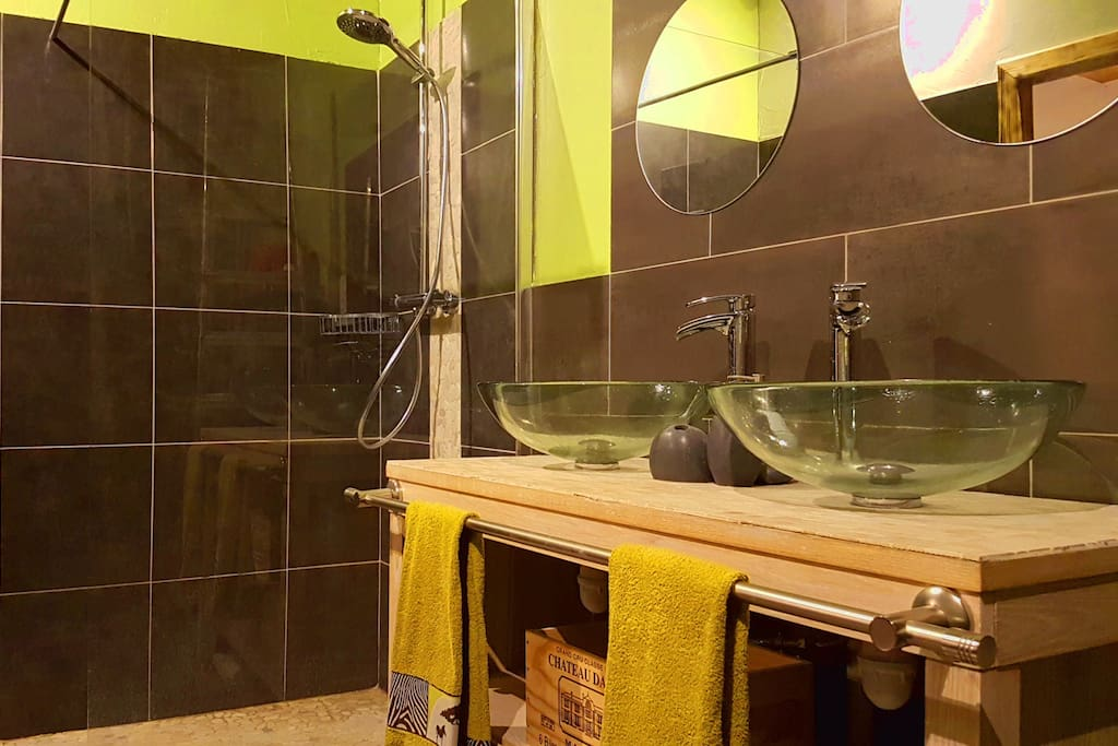 Shower room with double wash basins and double mirrors.