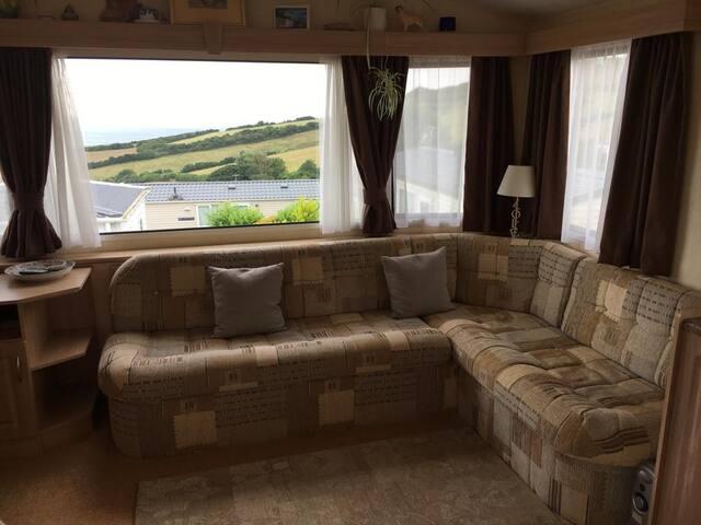 Relaxing two bedroom caravan with sea view.