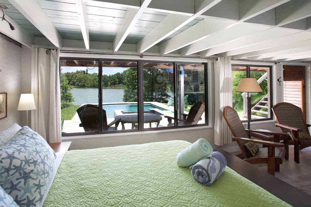 Wake up to this view overlooking the pool and lake!