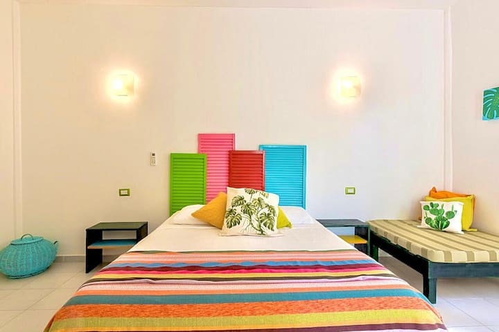 COLORFUL Mexican style suite wA/C and a POOLcomfy