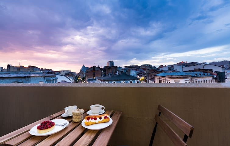 Relaxing cosy balcony for you to enjoy your dinner with a beautiful sunset view