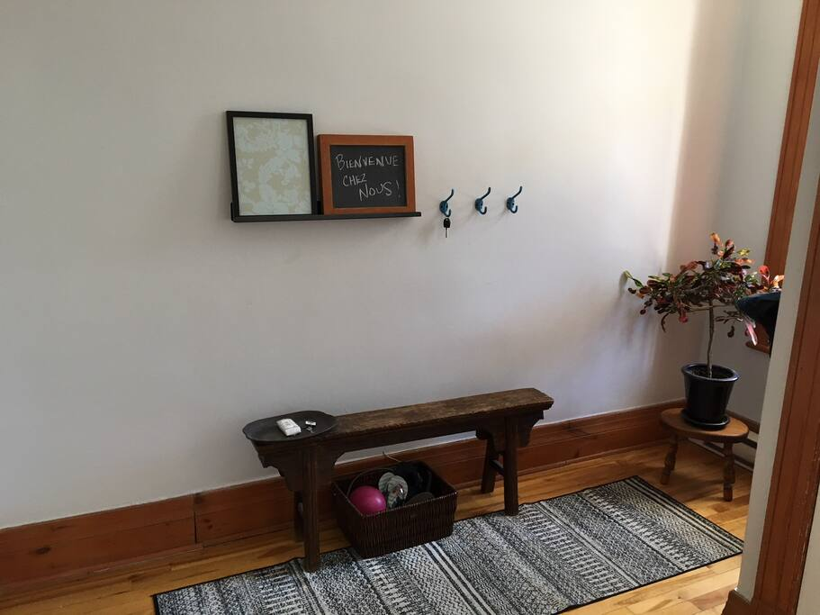 Entrance way with bench and large coat closet