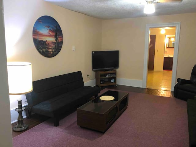 Living room with 2 full size futons that could be put together for queen size bed.